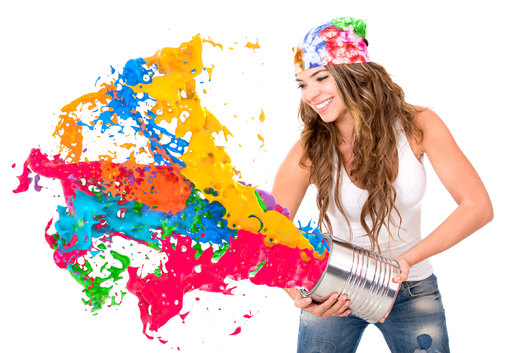 Woman splashing colorful paint from a can - isolated over white