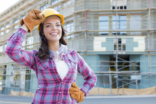 Portrait of Young Attractive Female Construction Worker Wearing