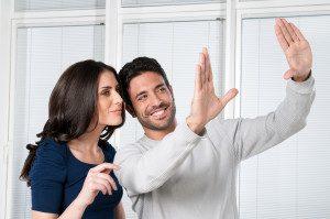 bigstock-Happy-satisfied-couple-looking-14508851-300x199-1